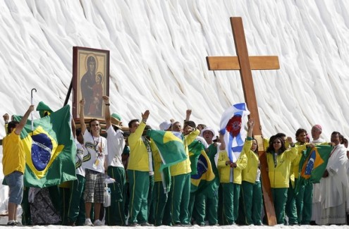 Brazilian pilgrims lift the World Youth Day cross at the Cuatro Vientos aerodrome in Madrid
