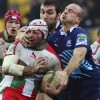 Biarritz's hooker Arnaud Heguy (2ndL) vies with Zebre's Ruggero Trevisan (R) during the European Rugby Union H Cup match  Zebre Parme vs Biarritz Olympique at the XXV Aprile stadium in Parma on January 12, 2013.  AFP PHOTO / GIUSEPPE CACACE