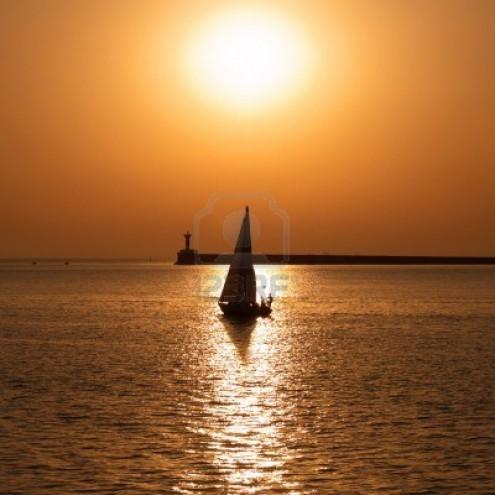 7294625-sail-boat-against-sea-sunset-colorful-marine-landscape