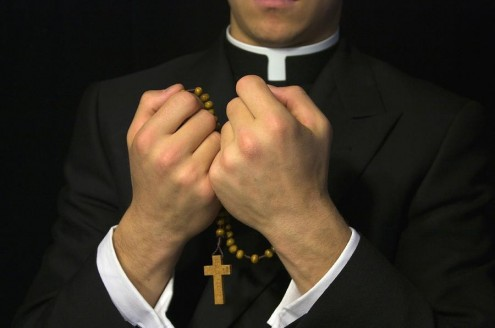 young-priest-praying-the-rosary-gregory-dean