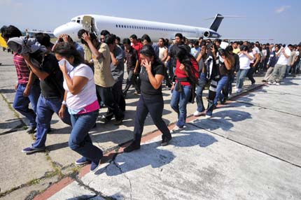 Guatemalan illegal immigrants deported from the United States wait walk along the tarmac upon their arrival back to Guatemala on November 7, 2008 in Guatemala City. Guatemala�s President Alvaro Colom hopes that the dossier about migration moves forward during the administration of recently elected United States President, Barack Obama, in view of the increasing number of deportations. In 2008, more than 24,000 Guatemalans have been deported. AFP PHOTO/Eitan Abramovich (Photo credit should read EITAN ABRAMOVICH/AFP/Getty Images)